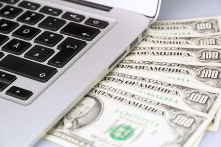 laptop keyboard and dollar money