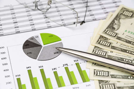 green Business Charts Green with calculator, Dollar Money, Glasses and pen Stock Photo