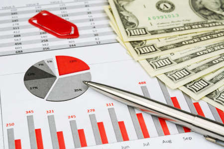 greenbacks: red business chart with pen and dollars and paper clip Stock Photo