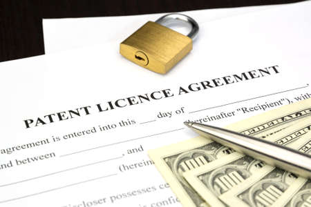 patent: Document Form of patent licence agreement with lock and dollar money