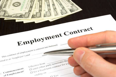 employment contract with dollar, hand and pen for signature photo