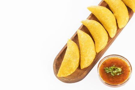 Colombian empanada with spicy sauce. Top view