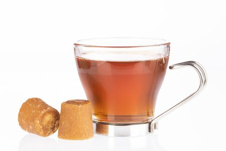 Fresh homemade Aguapanela, Agua de Panela or Aguadulce, a popular Latin American sweet drink made of panela unrefined whole cane sugar boiled in water, served warm or cold with lime