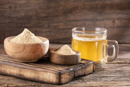 Maca root health drink in a glass with powdered - Lepidium meyenii. Text space