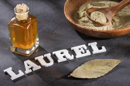 Organic laurel oil - Laurus nobilis. Laurel word in wooden letters