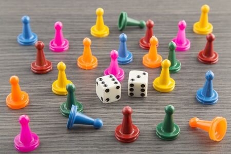 colorful wooden game pieces with dices