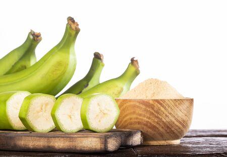 Raw and dried green bananas, plantain flour, resistant flour, prebiotic food, gut health Reklamní fotografie
