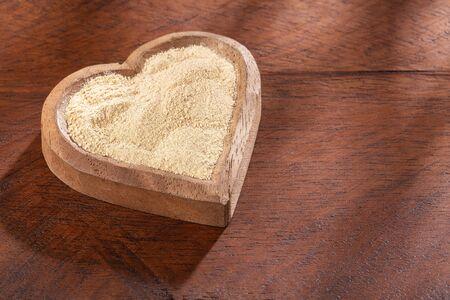 Lepidium meyenii - Dry organic powder superfood in a bowl Stock Photo
