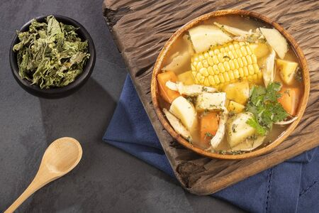 Colombian cuisine - ajiaco soup with chicken and vegetables