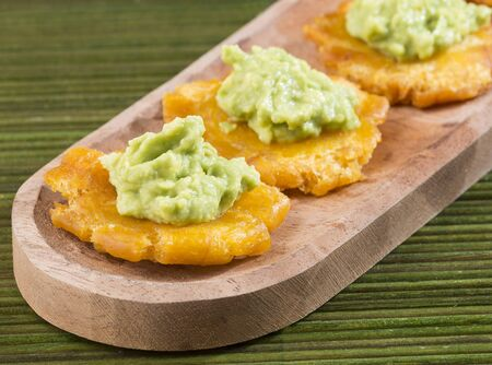 Fried green plantains or Tostones with guacamole