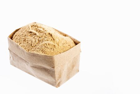 Dry Organic Maca Powder in paper bag - Lepidium meyenii Stock Photo