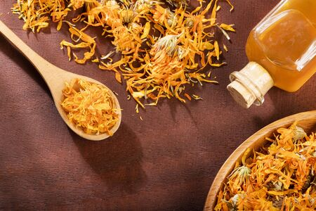 Aromatherapy essential oil with marigold flowers - Calendula officinalis