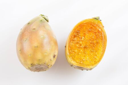 Fresh colorful cactus fruit and a cut one on a white background - Opuntia ficus-indica