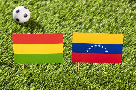 Flag of Bolivia and Venezuela in the football stadium - Cup America football match conmebol Brazil 2019. Standard-Bild