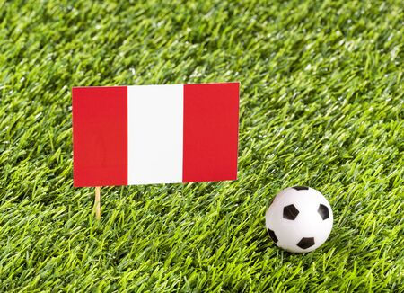 National flag of Peru with soccer ball in the stadium