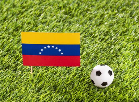 National flag of Venezuela with soccer ball in the stadium 写真素材