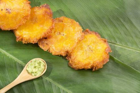 Patacón fried flattened pieces of green plantain (tostón, tachino)