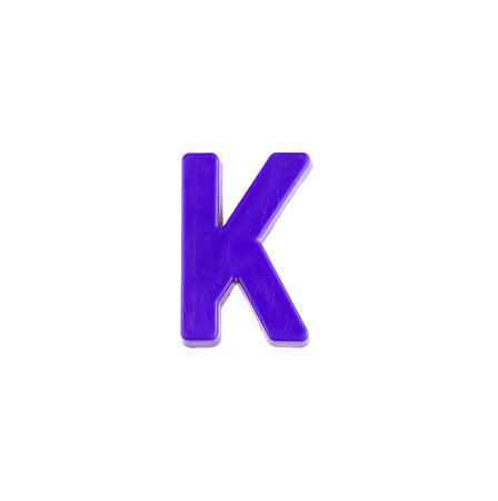 Letter K in violet color - Plastic piece Zdjęcie Seryjne - 140204373