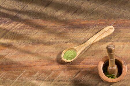 Organic moringa powder in the spoons - Moringa oleifera