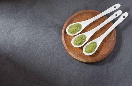 Moringa powder in three spoons - Moringa oleifera