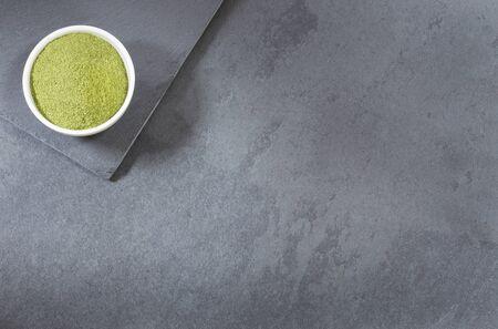 Organic moringa powder in the bowl - Moringa oleifera
