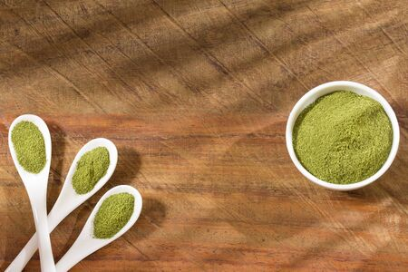 Organic moringa powder on wooden background - Moringa oleifera 스톡 콘텐츠