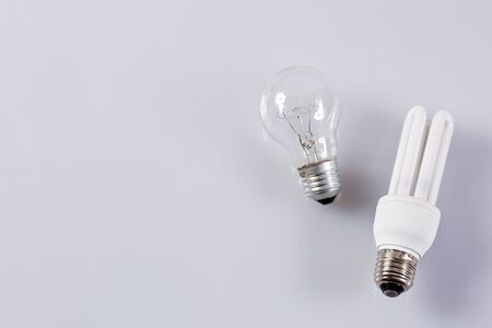 Traditional and energy efficient bulb. White background Stock Photo