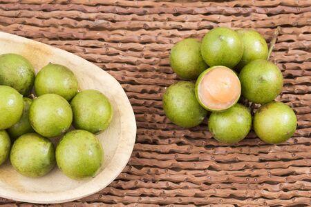 Fresh ripe peeled quenepa fruit - Melicoccus bijugatus. Top view Stock Photo
