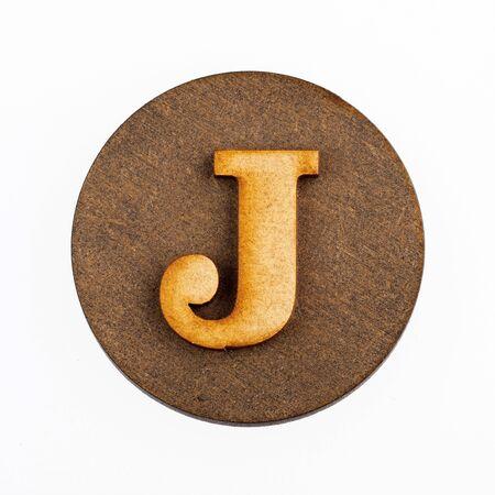 Letter J on a wood circle - Alphabet