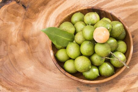 Fresh ripe peeled quenepa fruit - Melicoccus bijugatus Stock Photo