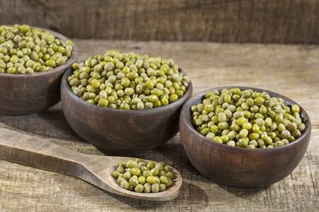 Mung bean, green moong dal in wooden bowl