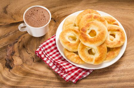 Pandequeso traditional Colombian food - Hot drink chocolate.