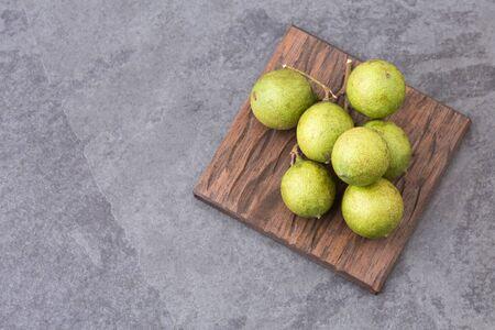 Fresh ripe peeled quenepa fruit - Melicoccus bijugatus. Top view