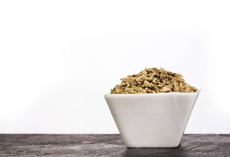 Fennel seeds in a small bowl - Foeniculum vulgare