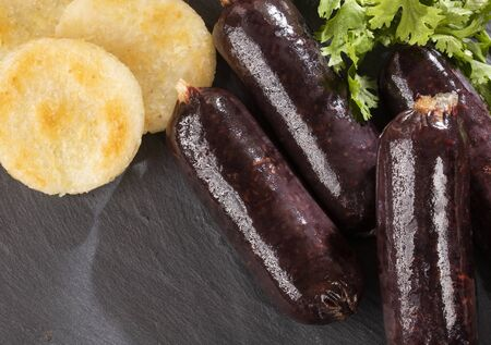 Whole blood sausage. Meat product in natural intestine casings