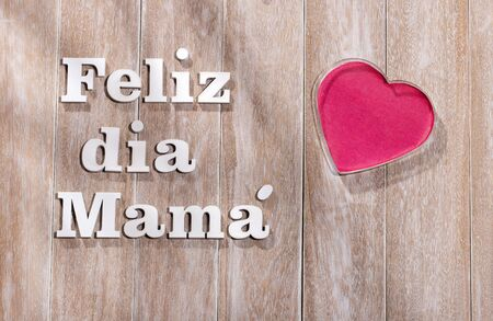 Happy mother's day, phrase in Spanish language in wooden letters