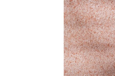 Fine grains of pink Himalayan salt, powder red rock salt from Pakistan