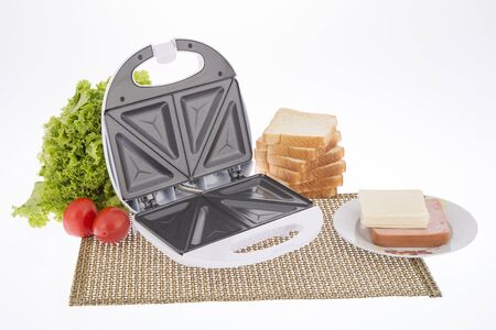 Open Sandwich Toaster with ingredients in a kitchen setting - White background