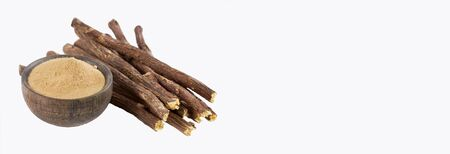 Closure of Ayurvedic herb Licorice root, Licorice root, Mulethi or Glycyrhiza glabra root on a wooden surface is very beneficial for Soothes your stomach, poisoning