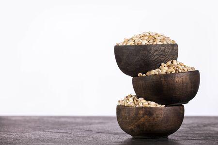 Hordeum vulgare - Pearl barley in three wooden bowls Zdjęcie Seryjne