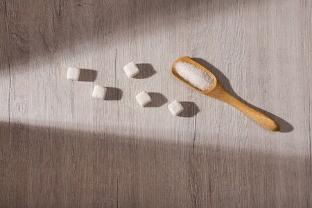 White sugar, refined and granulated in the cubes - Text space