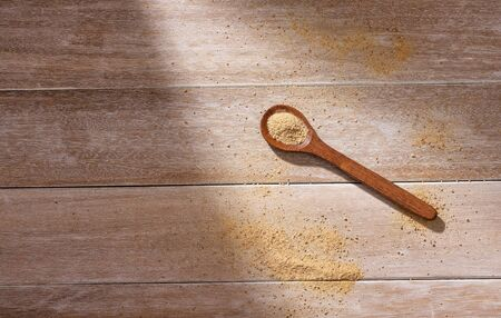 Lepidium meyenii - Maca powder in wooden spoon