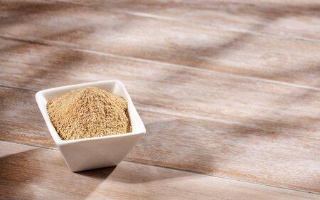 Lepidium meyenii - Organic maca powder. Text space Stock Photo