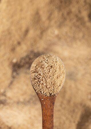 Lepidium meyenii - Maca powder in wooden spoon