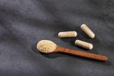 Lepidium meyenii - Organic Maca in a heart-shaped bowl, tablets