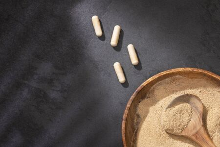 Organic Maca in a heart-shaped bowl, tablets - Lepidium meyenii