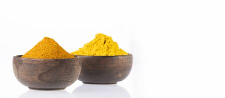 Turmeric and curry in wooden bowls - Text space