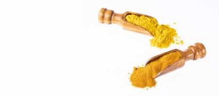 Turmeric and curry in wooden spoons - Text space
