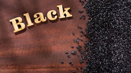 Black rice words in wooden letters - Oryza sativa