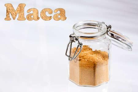 Organic maca root powder in glass jar - Lepidium meyenii Stock Photo